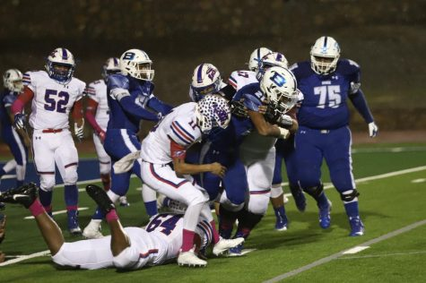 Turnovers Plague Football Team on Rainy Homecoming Night