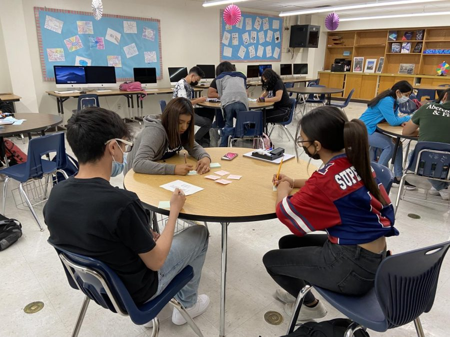 Newspaper students work together to complete an activity in Ms. Melson's class